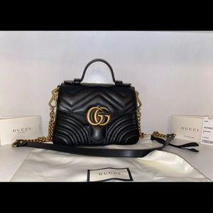 Gucci GG Marmont mini top handle bag.